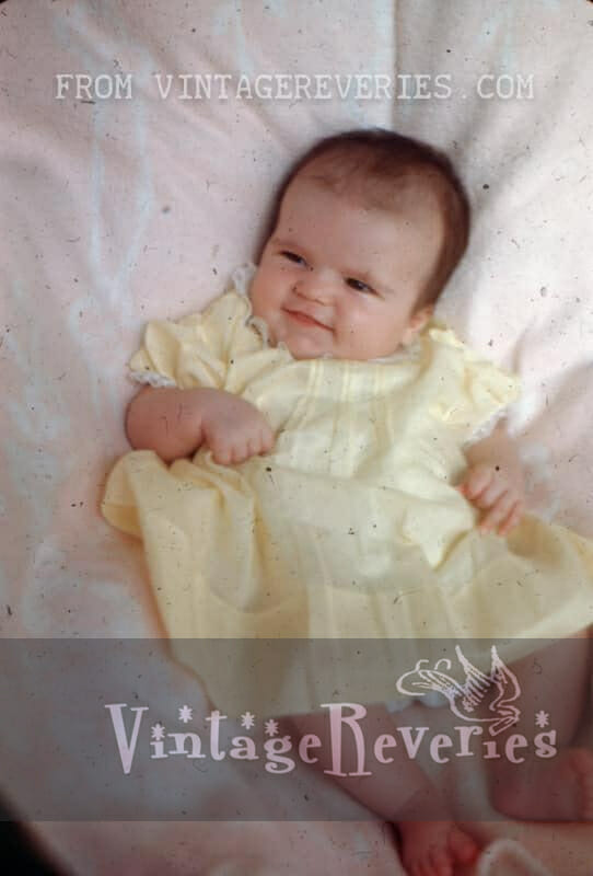 1940s baby in a yellow dress