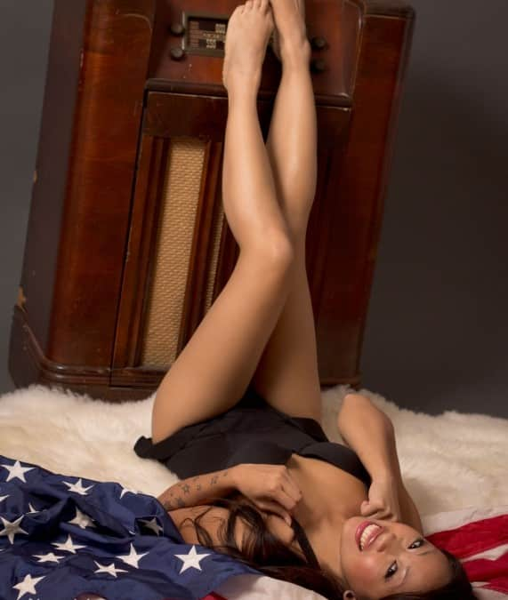 Pinup Girl with a Flag and Old Radio
