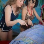 Pinup models on a South Pacific Set