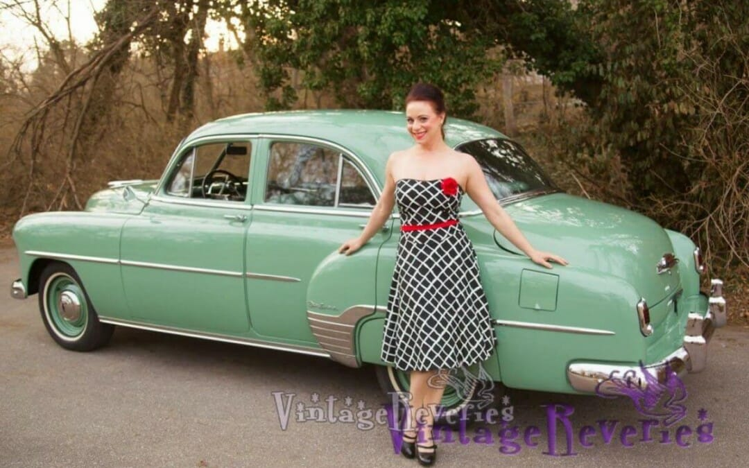 Pinup pics of June Ann with 2 vintage cars, a black Bel Aire and a green Chevrolet