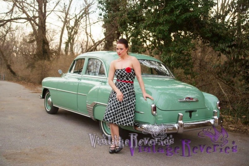 pinup model with a vintage car