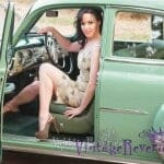 Pinup model with a green vintage car